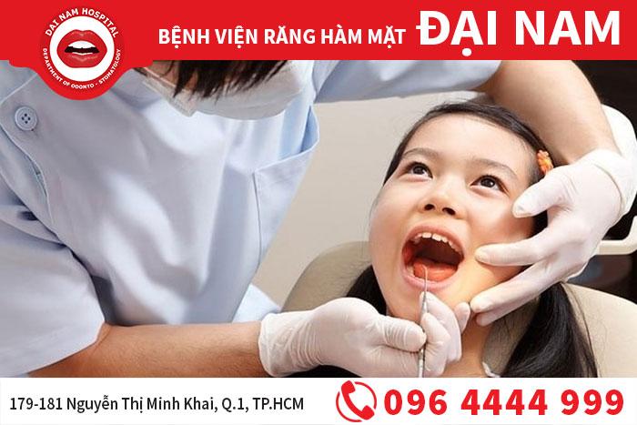 nhổ răng sữa cho trẻ